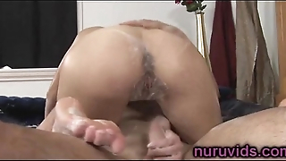 Sweet busty masseuse gives soapy massage